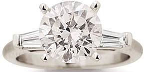 3.02 carat round brilliant cut diamond set in a platinum engagement ring (Note the two baguette diamonds on either side.