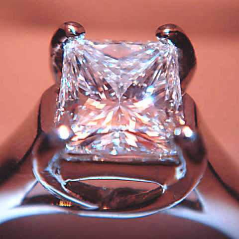 A princess cut diamond set in an engagement ring