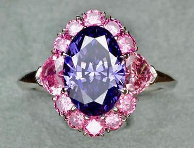 Argyle Violet Diamond set in a designer ring surrounded by Argyle vivid pink diamonds