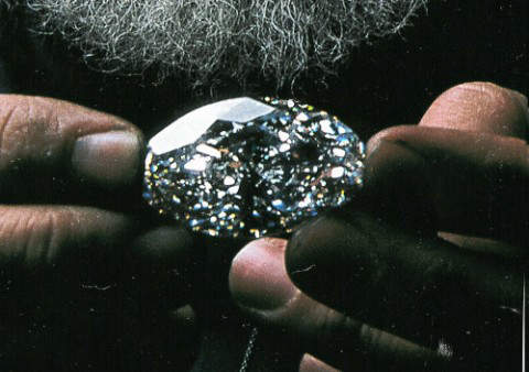Beluga Diamond being held by one of the workers of William Goldberg Diamond Corporation