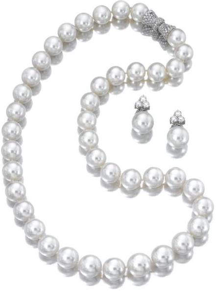 Cultured pearl and diamond necklace and matching pair of earrings