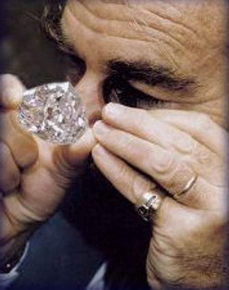Gabi Tolkowsky Examining the Centenary Diamond with a Jeweler's Loop