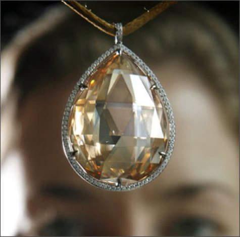 Fancy orange-brown briolette-cut diamond - 100.60 carats