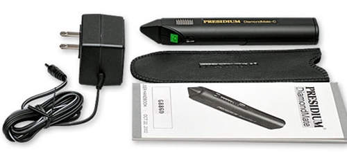 Presidium Electronic Diamond Tester and kit. It comes with rechargable batteries and adaptor.
