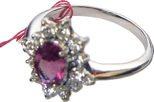 Cluster ring with a Ceylon Pink Sapphire in the center surrounded by diamond,set in 18k white gold.