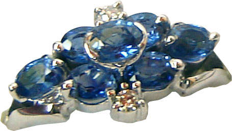 Ring of unique design with a floral pattern consisting of seven Ceylon blue sapphires and two diamonds set in 18k white gold.