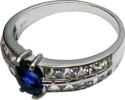 Ring of unique design with a large Ceylon(Sri Lanka) blue sapphire and diamonds set in 18 ct white gold.
