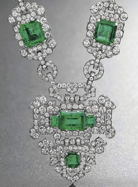 Shield-shaped emerald and diamond pendant