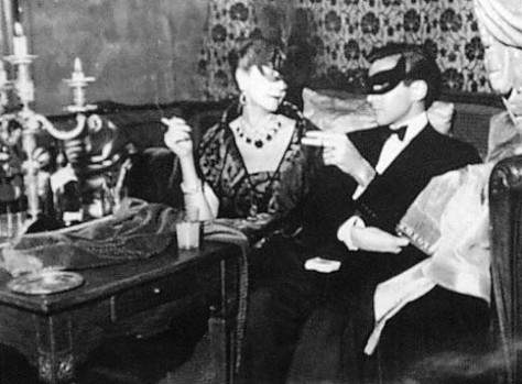Barbara Hutton at a Masked Ball in Paris 1958, wearing the Catherine the Great Emerald Necklace