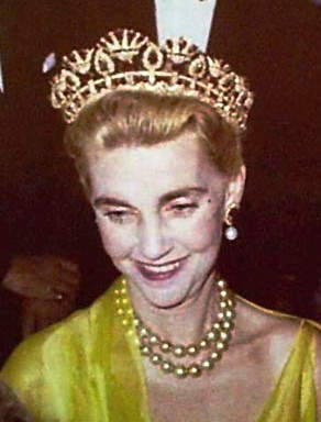 Barbara Hutton wearing the queen Amelie of Portugal Ruby Necklace converted to a tiara and the double-stranded golden yellow Japanese Pearl Necklace