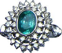 Cluster ring with a large Brazilian emerald and diamonds set in 18ct white gold