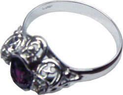 Ring of unique design with a Ceylon (Sri Lankan) violet sapphire and diamonds set in 18ct white gold.