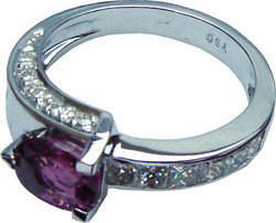 Ring of unique design with a Ceylon (Sri Lanka) Ceylon Pink Sapphire and diamonds set in 18ct white gold.