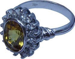 Cluster ring with an attractive design made up of a large Ceylon(Sri Lanka) yellow sapphire and diamonds set in 18ct white gold.