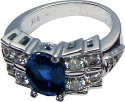 Attractive bridge ring with high quality large Ceylon blue sapphire and diamonds set in 18ct white gold.