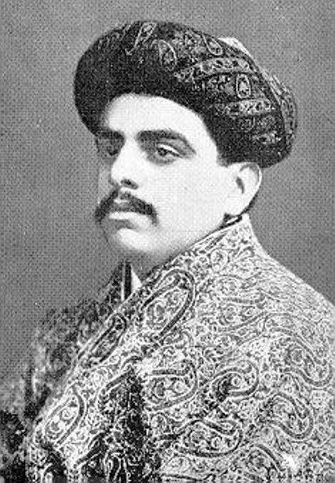 Young Prince Sultan Muhammad Shah in the traditional robes of an oriental monarch